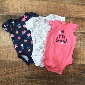 Set of adorable Carter's onesies